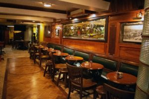 oldest pubs in Cork tables with chairs in a bar