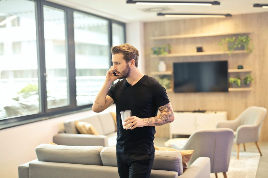 Are remote internships the new internships man on telephone with coffee in hand