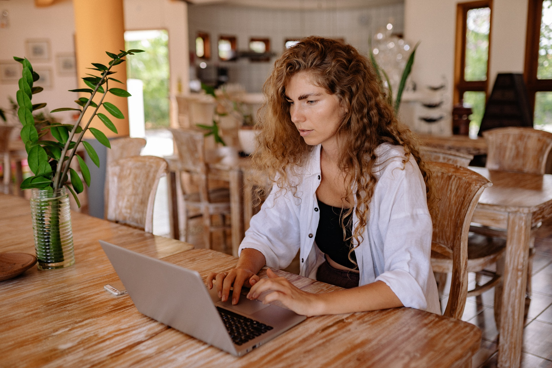 How to stay working while working from home woman on desk with laptop